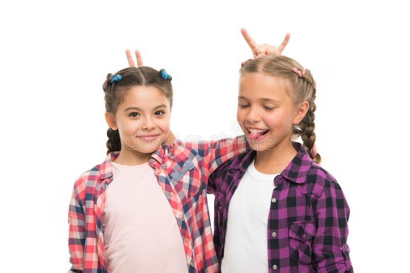 Cheerful friends. Happy childhood. Keep hair braided. Sisters with long braided hair. Hairdresser salon. Having fun stock images