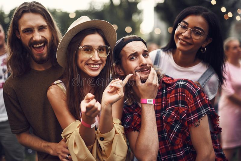 Cheerful friends having fun while spending time outdoors stock photography