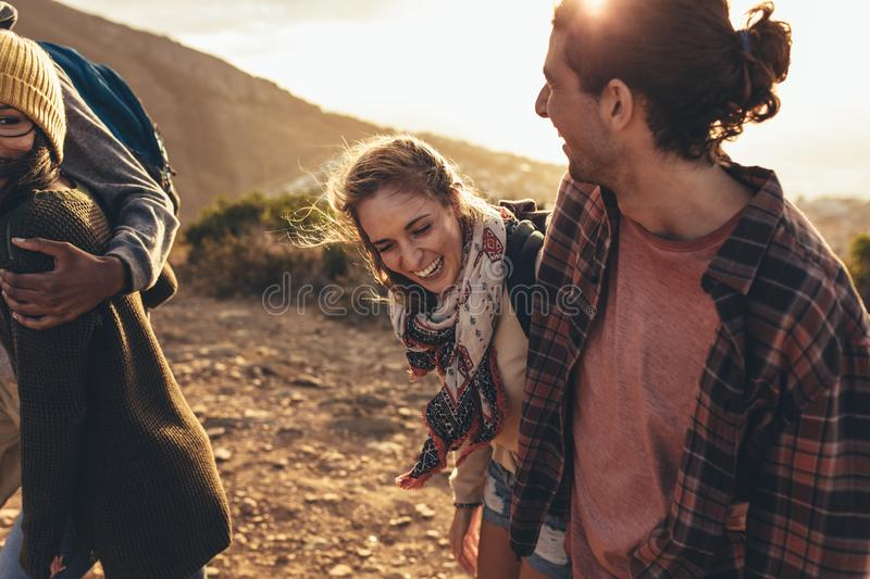Young people having fun on hiking trip. Cheerful friends hiking together on mountain trail. Group of friends having fun while hiking together stock images