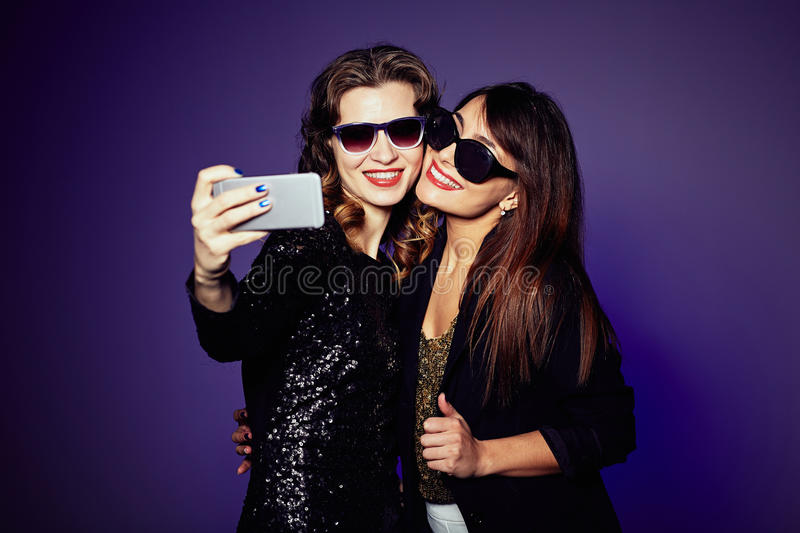 Cheerful Friends Taking Picture of Themselves royalty free stock images