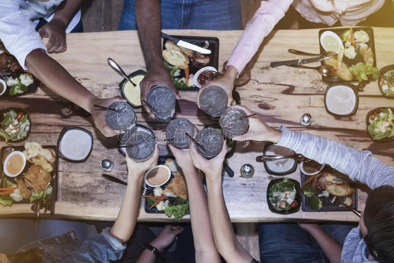 Cheerful friendship, team are dining on holiday or success business celebration party. royalty free stock photo