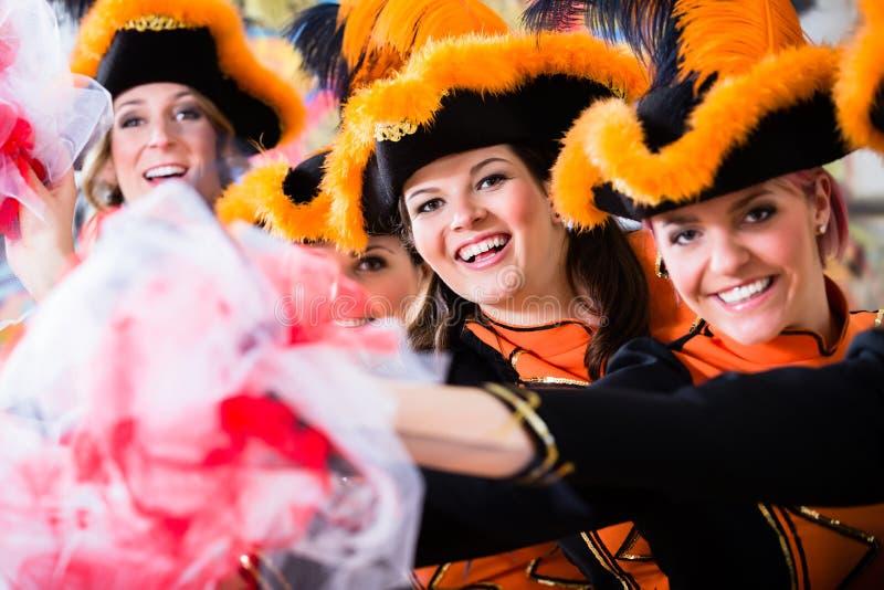 German traditional dance group Funkenmariechen in carnival celebration. Cheerful German traditional dance group Funkenmariechen in carnival celebration stock photos