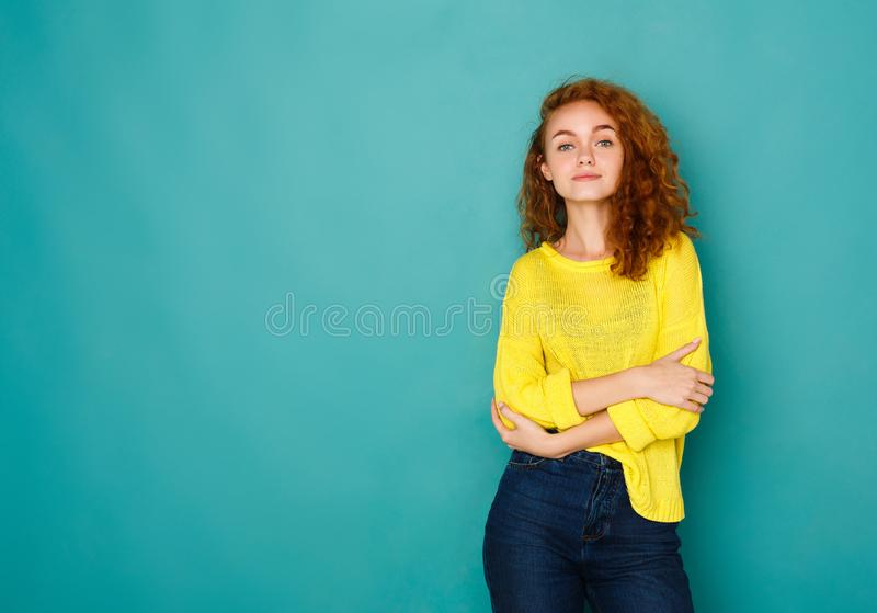 Cheerful girl in casual clothes posing at studio royalty free stock image