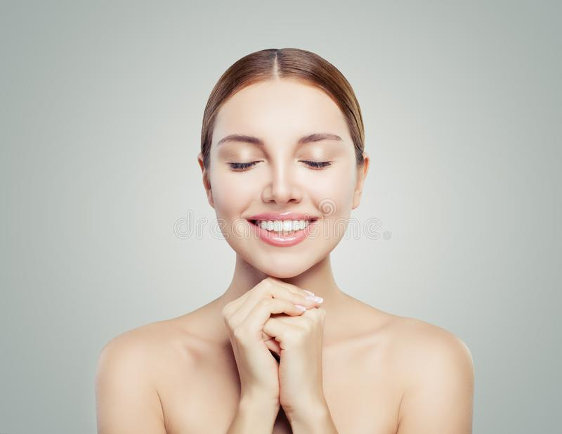 Cheerful girl with closed eyes portrait. Beautiful woman with healthy skin. Spa beauty, skincare and cosmetology concept.  royalty free stock image