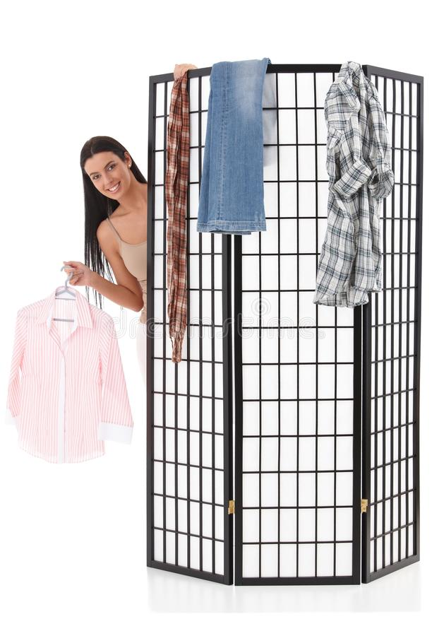 Download Cheerful Girl Dressing Up Behind Dressing Panel Stock Image - Image: 20050433