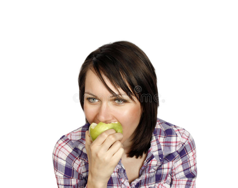 Cheerful girl eating an apple royalty free stock photo