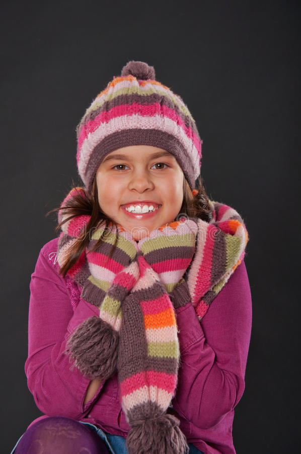 Download Cheerful Girl With A Hat And Skarf Stock Image - Image: 26926449