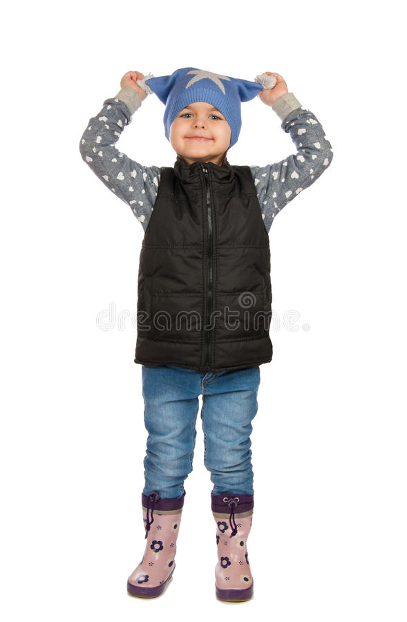 Cheerful girl holding himself for his hat. Isolation on a white background stock photos