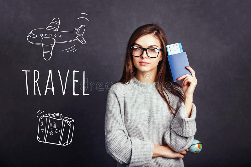 Girl with Passport and Plane Ticket stock image