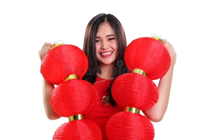 Cheerful girl holding red lanterns, closeup portrait on white background royalty free stock images