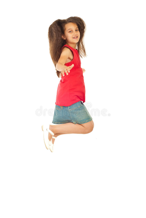 Download Cheerful girl leaping stock photo. Image of content, jump - 20064556