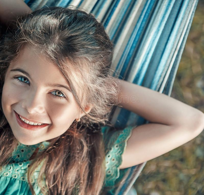 Cheerful girl resting on the hammock royalty free stock photo