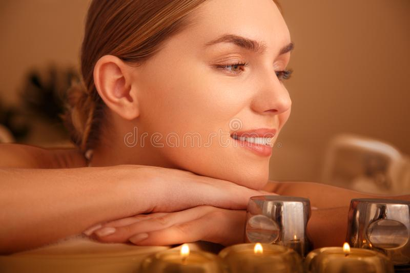 Cheerful girl taking a bath with comfort royalty free stock photo