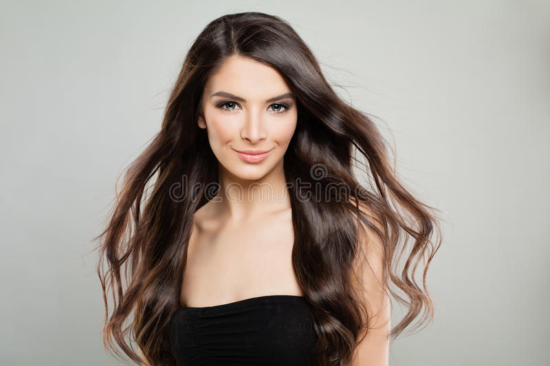 Cheerful Girl with Windy Hair. Fashion Model Woman. On Grey Banner Background stock photography
