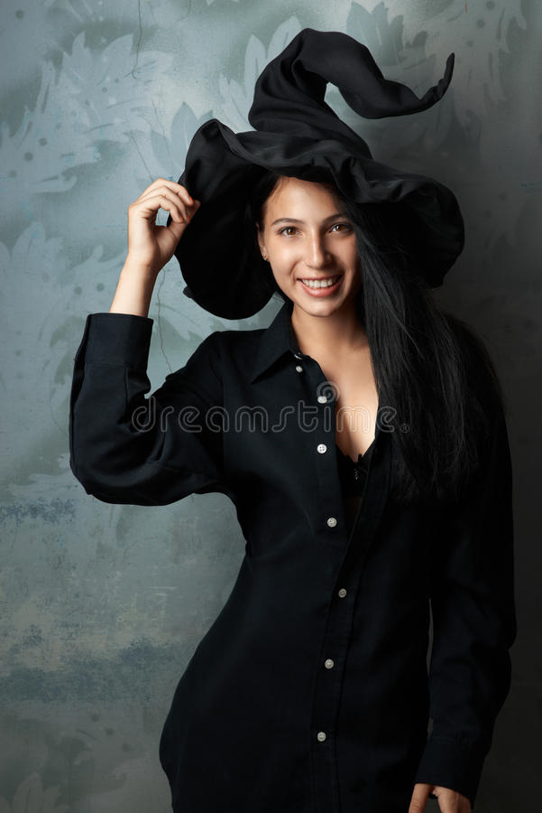 Cheerful girl in witch costume smiling. Beautiful cheerful girl in witch costume smiling stock photography