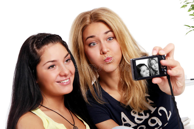 Cheerful girlfriends with photo camera stock image