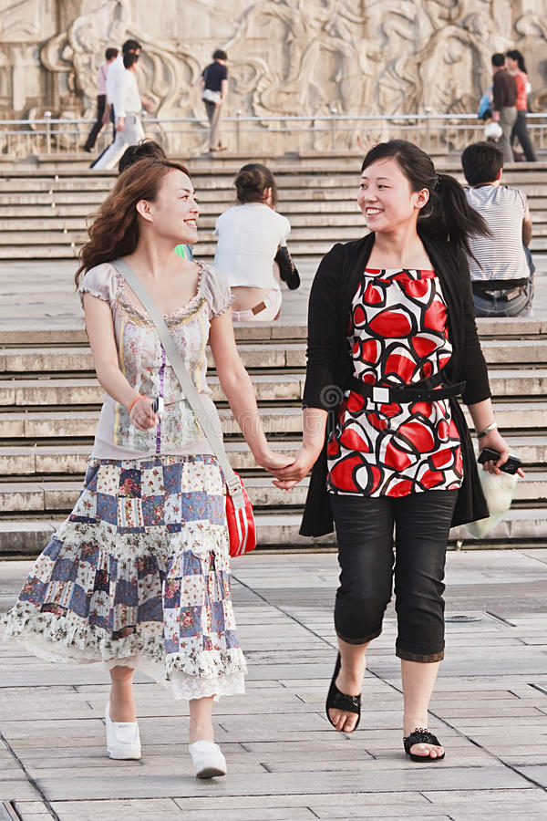Cheerful girls hand in hand on a square, Xian, China royalty free stock images