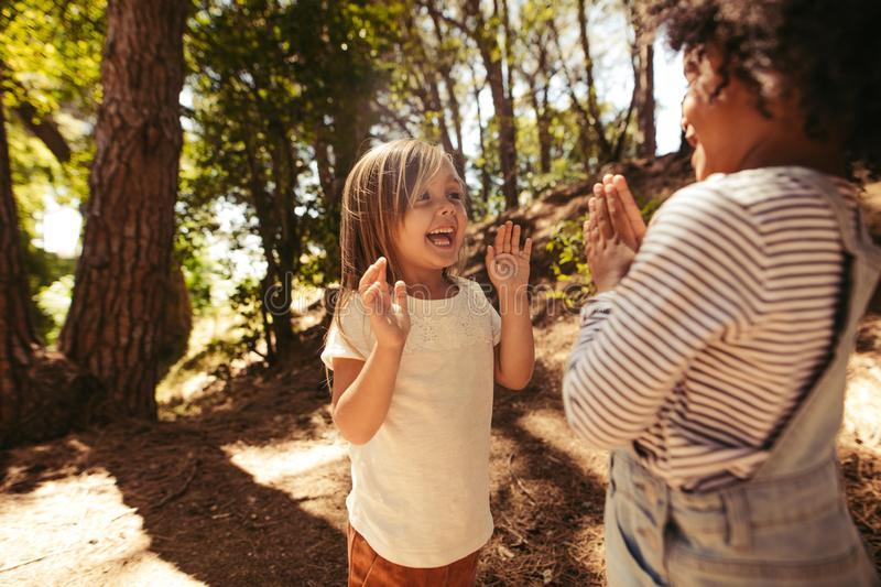 Cheerful girls playing clapping games stock photo