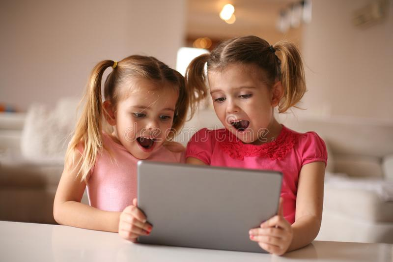 Cheerful girls using IPod. Close up image. royalty free stock images