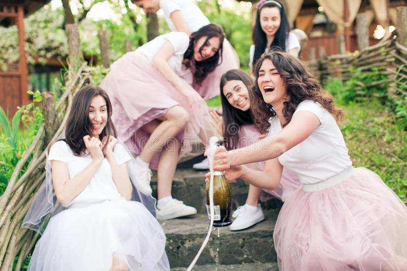 Moment of champagne bottle opening while hen party royalty free stock photos