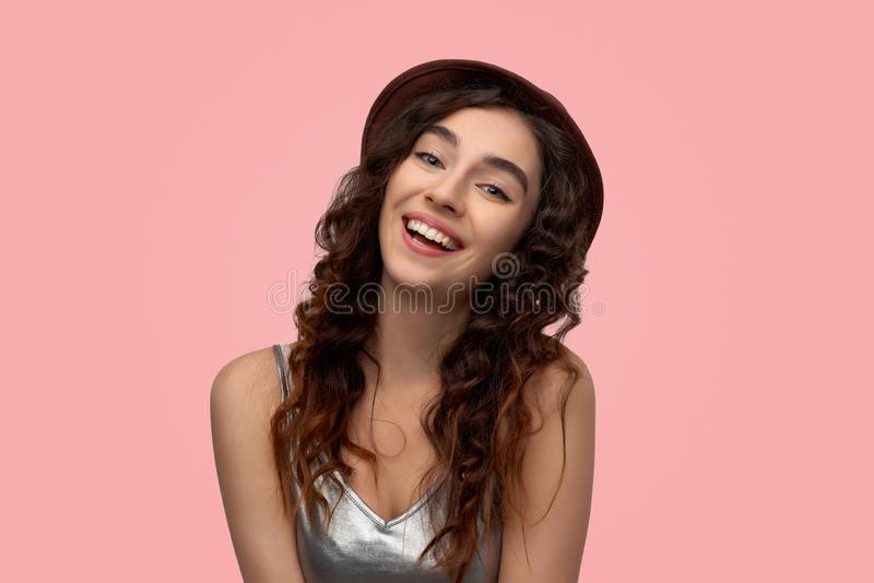 Cheerful gorgeous young woman smiling happily while receiving some positive news stock photography