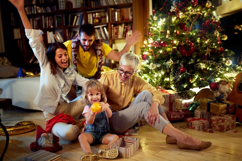 Cheerful grandmather and her family together for Christmas stock photos