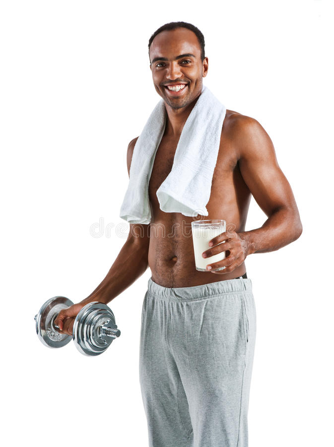 Cheerful guy with towel and glass of milk stock photos