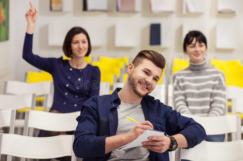 Cheerful guy and women are studying stock photos