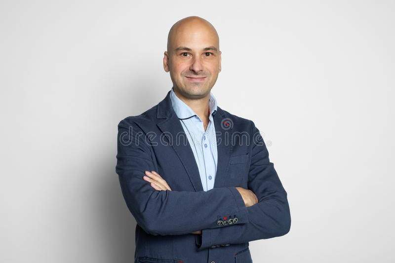 Cheerful handsome bald man smiling. Isolated stock photos