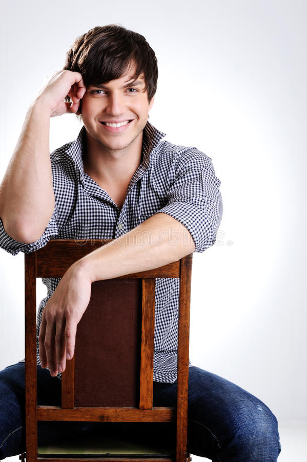 Cheerful and happy beautiful young guy stock photo