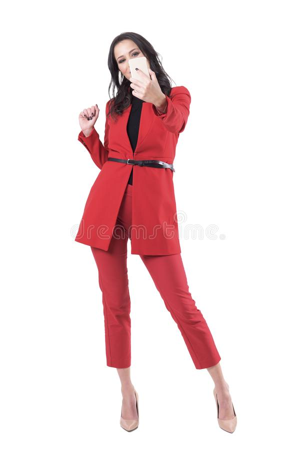 Cheerful happy excited business woman taking selfie photos with smart phone royalty free stock image