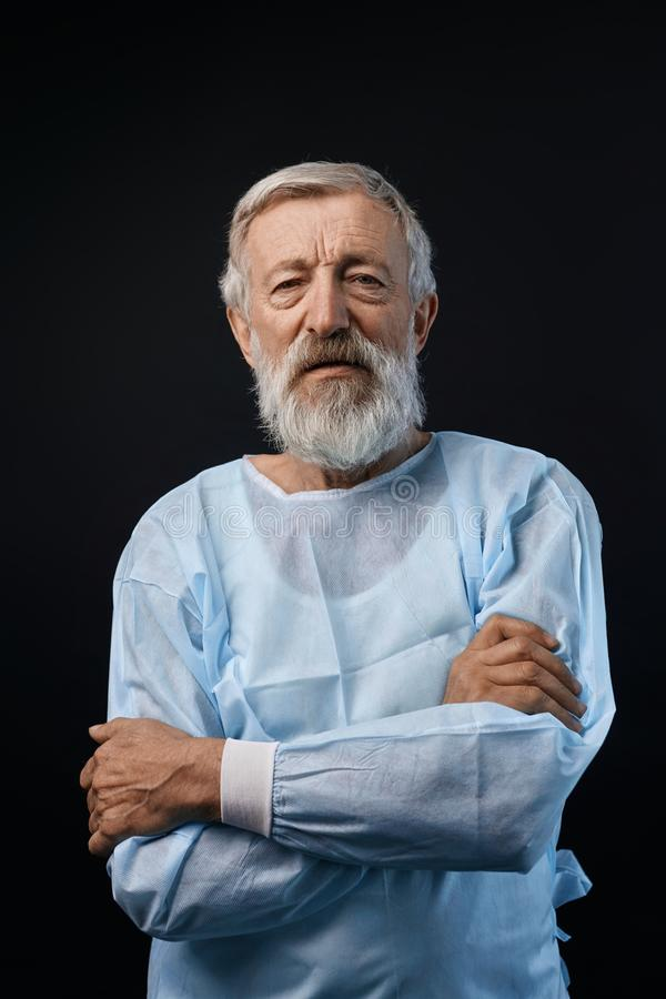 Cheerful happy mature patient standing with crossed arms and looking at the camera stock photos