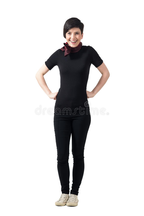 Cheerful happy woman looking at camera with hands on hips. stock photos