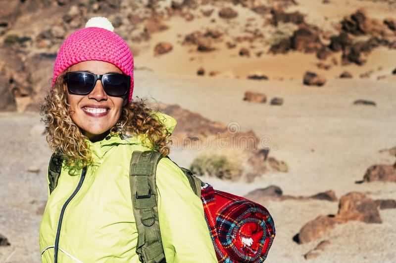 Cheerful happy young caucasian woman smile and enjoy trekking outdoor leisure activity with mountain and desert in backgorund -c stock photos