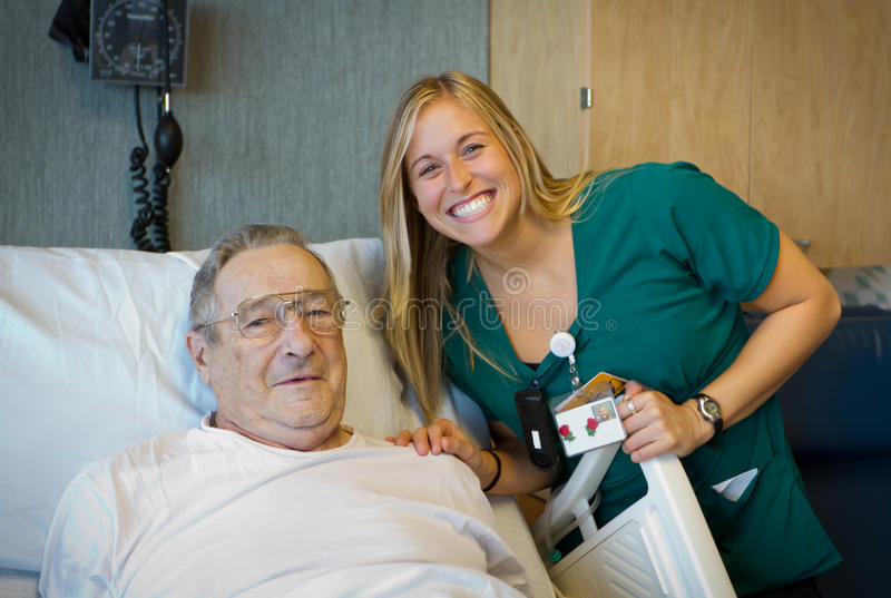 Cheerful healthcare worker with her patient. royalty free stock photo