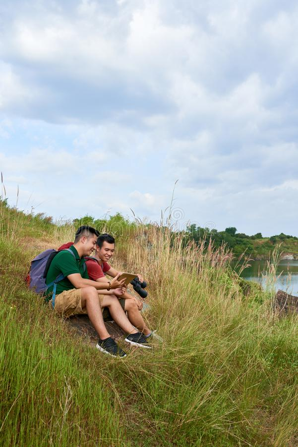 Hikes resting by lake stock image