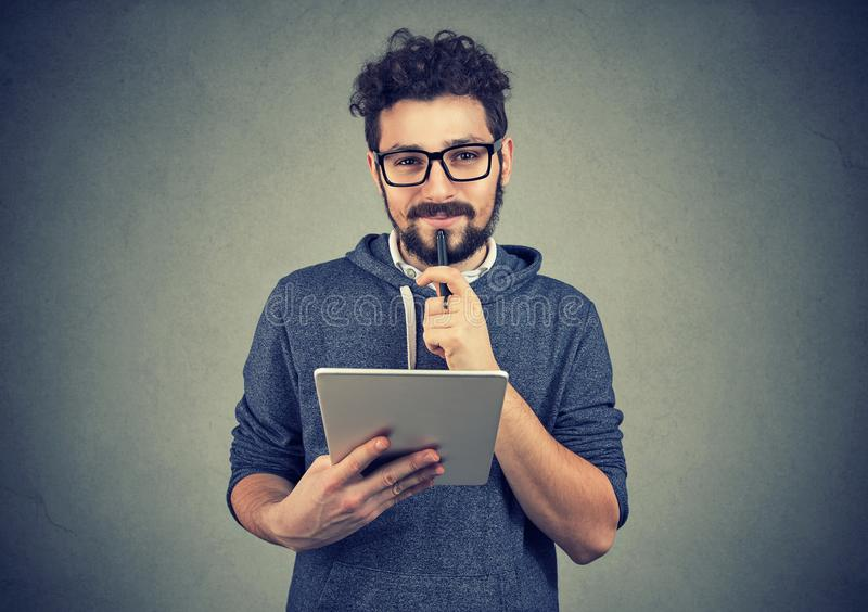 Cheerful hipster man with pad computer royalty free stock photo