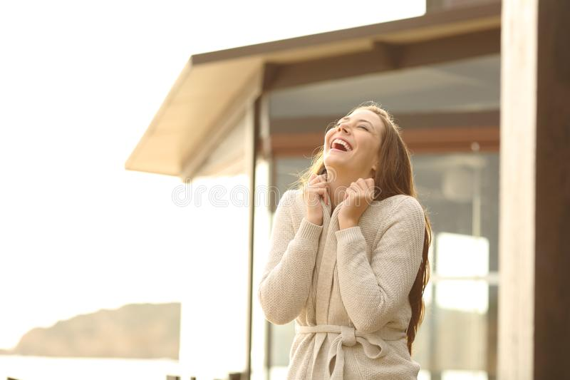 Cheerful hotel guest breathing fresh air. And laughing royalty free stock photo
