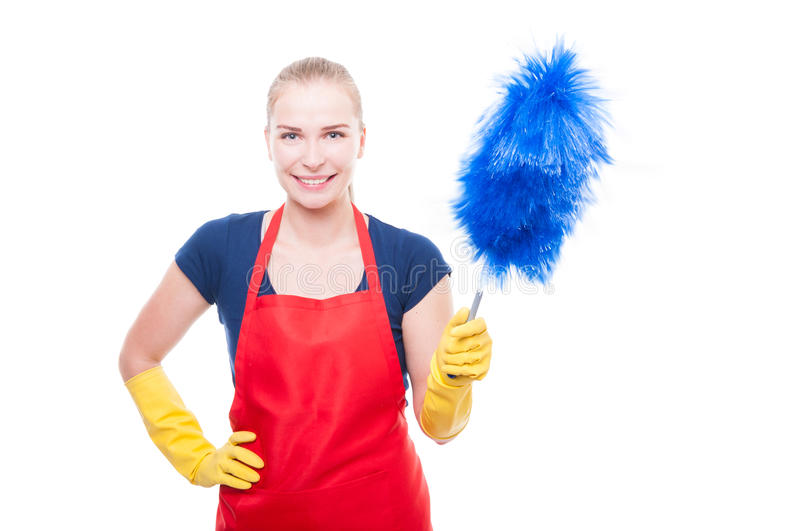 Cheerful housekeeper with dust cleaner. Doing her job isolated on white background royalty free stock photos
