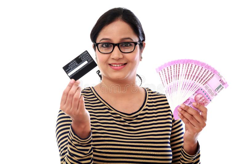 Cheerful Indian woman holding Indian rupee and credit cards stock photos