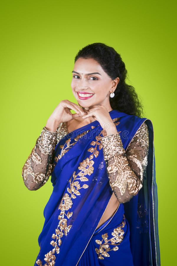 Cheerful Indian woman posing and smiling royalty free stock image