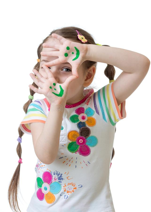 Cheerful kid girl showing her hands painted in bright colors. royalty free stock images