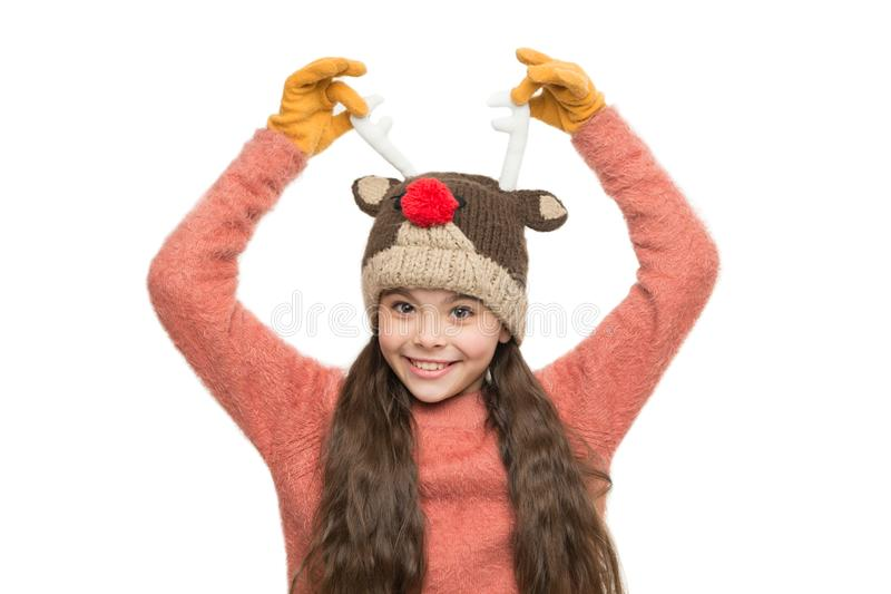Cheerful kid. Playful cutie. Adorable baby wear cute winter knitted hat. Cute reindeer with red nose. Cute accessories royalty free stock image