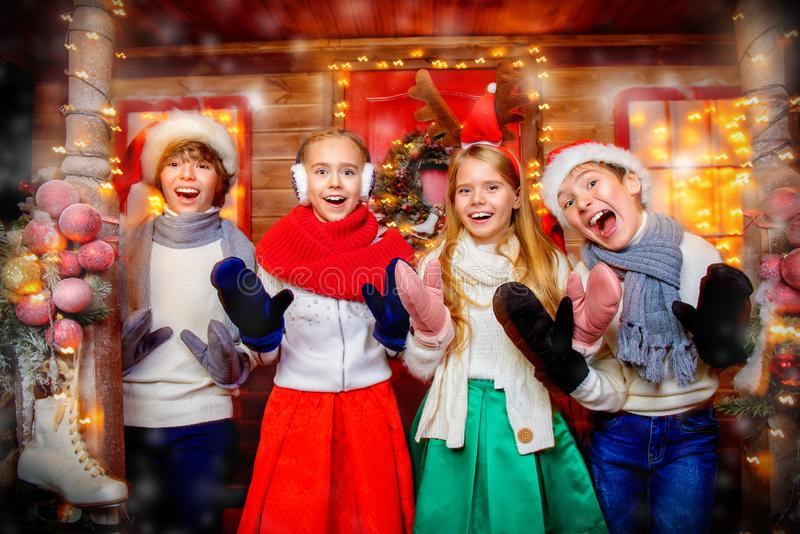 Cheerful kids at christmas royalty free stock photography