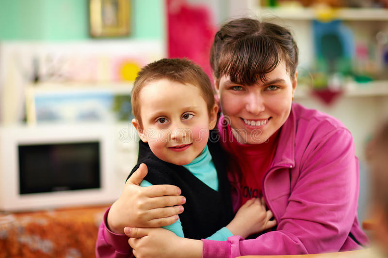 Cheerful kids with disabilities in rehabilitation center stock image