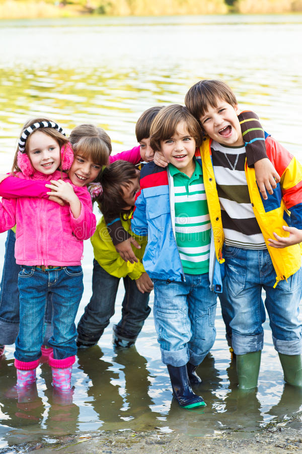 Cheerful kids group stock photos
