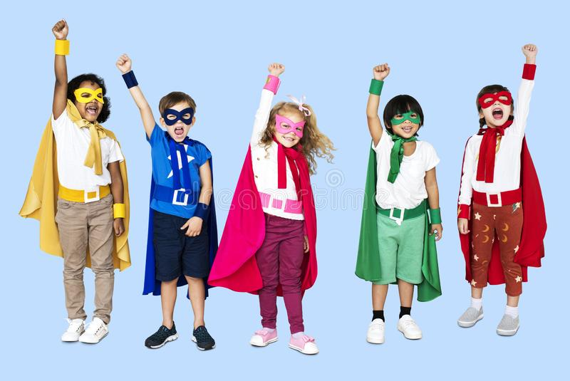 Cheerful kids wearing superhero costumes royalty free stock photography