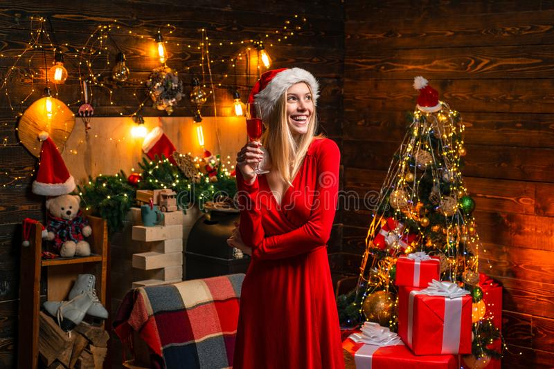 Cheerful lady in dress corporate christmas party. Happy new year party. Celebrate christmas. Woman elegant girl red. Dress celebrate christmas. Girl near royalty free stock images
