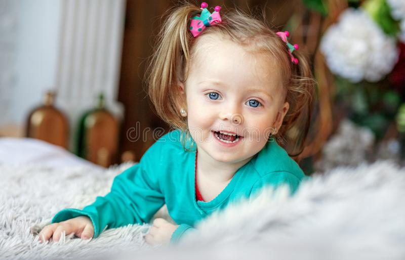 Cheerful little baby playing in the room. 2-3 years. The concept royalty free stock photo