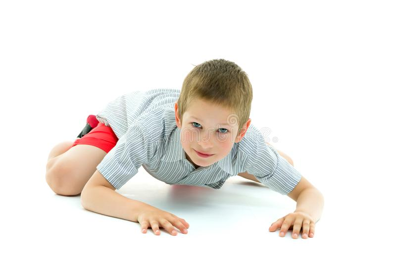 A little boy is crawling on the floor. The concept of children`s stock photo